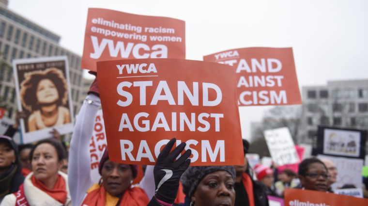 Photo of participants holding Stand Against Racism signs