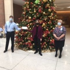 Evanston Hospital employees present $5,000 check