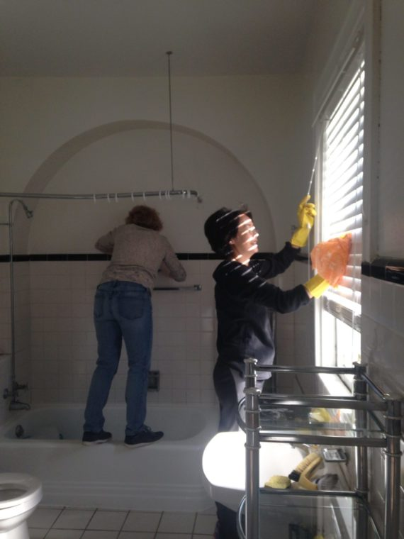 Volunteers working on cleaning and repainting a shelter room
