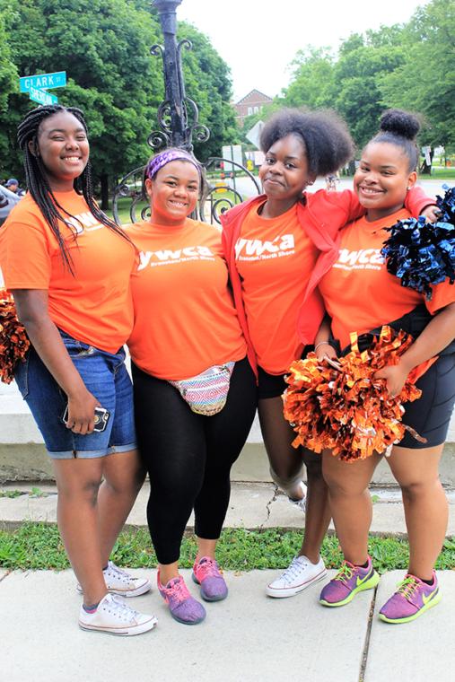 Four volunteers at the Race Against Hate wearing orange YWCA teeshirts.