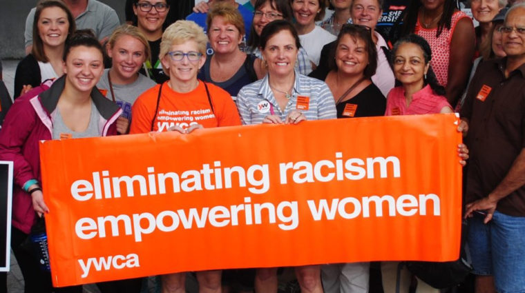 Women holding YWCA banner