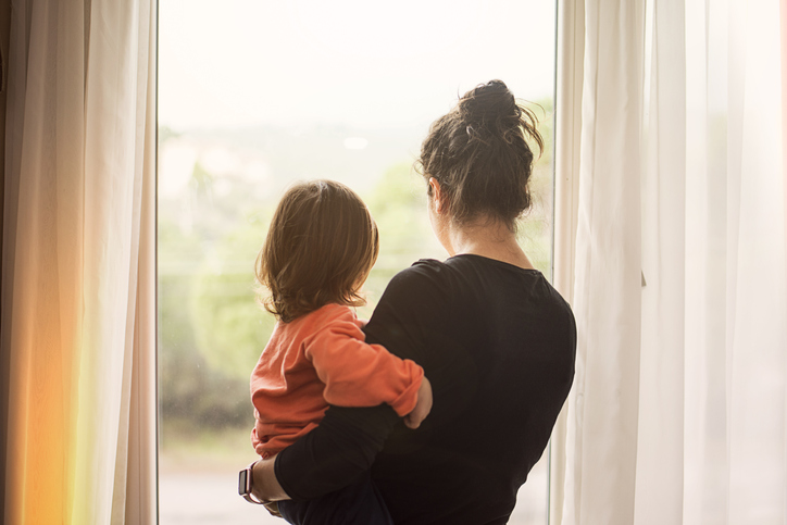 Woman and child at window